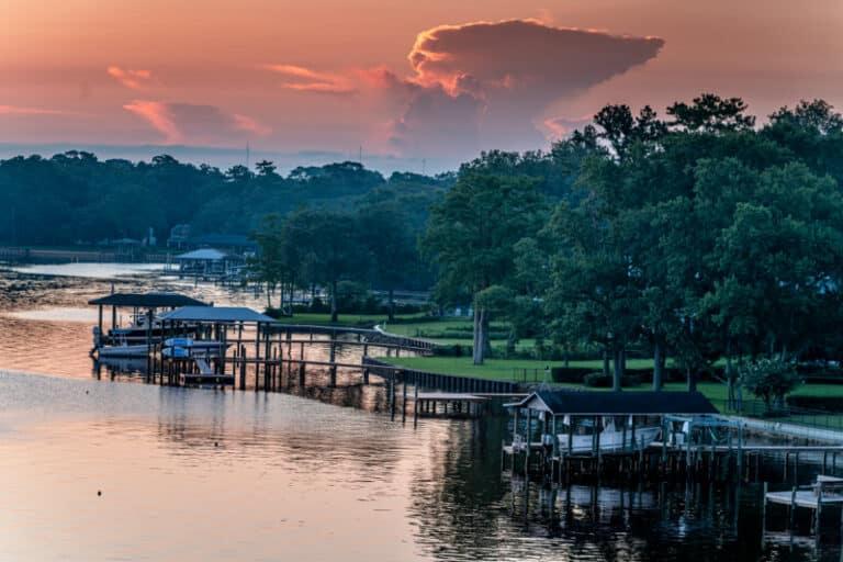 Ortega River at sunset with orange sunset and docks